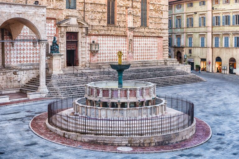 View of Fontana Maggiore, monumental medieval fountain located between the cathedral and the Palazzo dei Priori in the city of Perugia, Italy